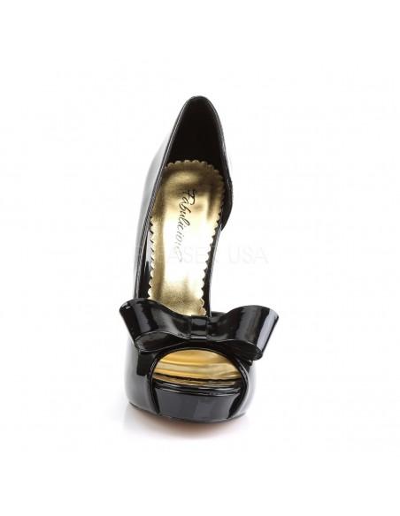 Coquetos zapatos de charol diseño Dorsay con gran lazo sobre los dedos