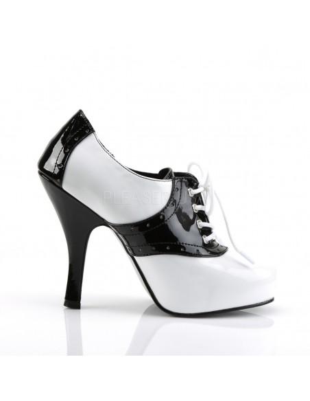 Zapatos de charol en dos tonos blanco-negro y acordonados